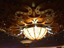 Glass slippers on the chandelier. I love the details!